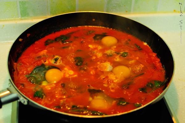 Shakshuka: eggs added