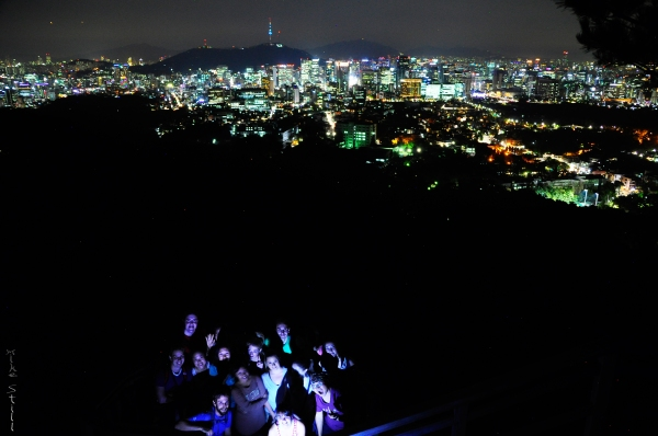 Seoul Hiking Group's night crew with a view of Seoul from Bukaksan